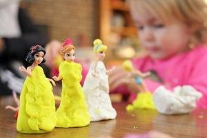 little girl playing playdough